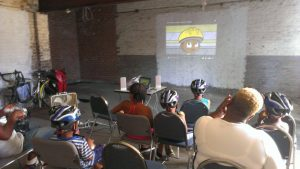 Students and parent at Swift Factory summer bicycle safety education with BiCi Co.