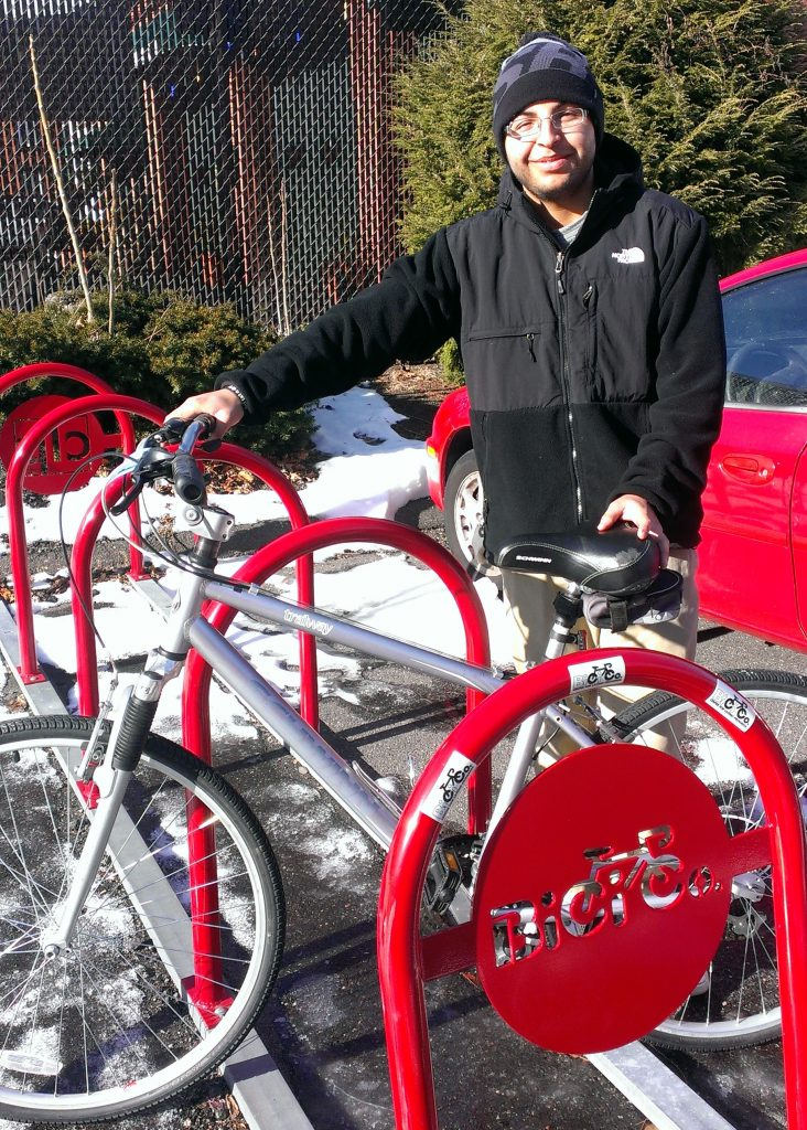 Ken (Earn-a-Bike Alumni) demonstrates the BiCi Co. Smile!